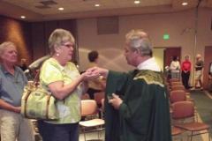 Fr. Gerry distributes communion, OMI