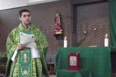 Padre Leandro at Mass in Room 4, WLIFC