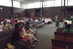 Padre Leandro at Mass in Room 1, WLIFC