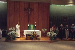 Presider & musicians at Mass in Room 1, WLIFC