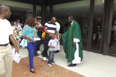 Fr. Ferdinand greets parishioners outside of WLIFC