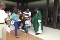 Fr. Ferdinand greets parishioners outside of WLIFC